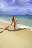 Girl with surfski Stock Image