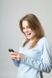 Girl surprise on cell phone Stock Image