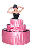 Girl, a surprise gift, jumps out of the toy cake Royalty Free Stock Photos