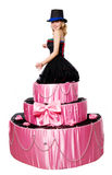 Girl, a surprise gift, jumps out of the toy cake Stock Photos