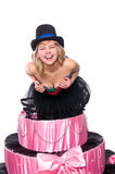 Girl, a surprise gift, jumps out of the toy cake Stock Photo