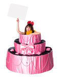 Girl, a surprise gift, jumps out of the toy cake Royalty Free Stock Photography