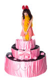 Girl, a surprise gift, jumps out of the toy cake Royalty Free Stock Images