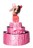 Girl, a surprise gift, jumps out of the toy cake Stock Photography