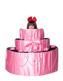 Girl, a surprise gift, looks out a toy cake Stock Photography