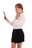 Girl with surprise is looking at tablet pc Royalty Free Stock Photos