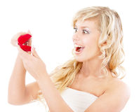 Girl with surprise looks at box with wedding ring Stock Image