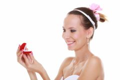Girl with surprise looks at box with wedding ring, isolated Stock Images
