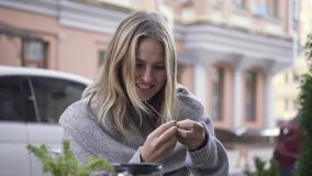 Girl in surprise looks at the spoon. Focus with a spoon. Illusionist played the girl stock video