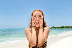 Girl surprised at the beach Stock Photos