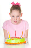 Girl surprised with cake Royalty Free Stock Photo