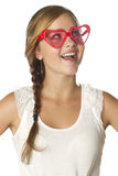 Girl surprised emotion with heart sunglasses Royalty Free Stock Images