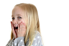 Girl with surprised expression has her hands on cheeks Royalty Free Stock Photo