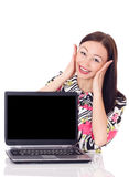Girl with surprised expression on laptop. Beautiful woman finds something funny online.  on white Royalty Free Stock Image