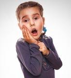 Girl surprised little teenager feels joy holding Royalty Free Stock Image