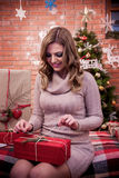 Girl surprised with the presents. Girl surprised with Christmas presents royalty free stock photos