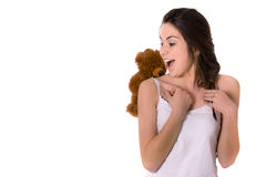 girl surprised by teddy bear Royalty Free Stock Photos