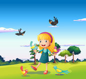 A girl surrounded by birds at the hill Stock Images