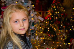 Girl surrounded by Christmas light. Girl walks on a bright colorful Christmas bazaar royalty free stock photography