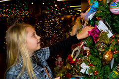 Girl surrounded by Christmas light. Girl walks on a bright colorful Christmas bazaar stock images