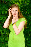 Girl is surrounded by greenery Stock Photo