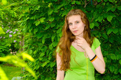Girl is surrounded by greenery Stock Photography