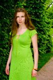 Girl is surrounded by greenery Royalty Free Stock Photography