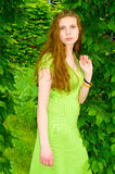 Girl is surrounded by greenery Royalty Free Stock Photo
