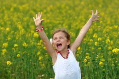 Girl surrounded by rapeseed flowers Royalty Free Stock Photography