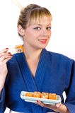 Girl and sushi Royalty Free Stock Image