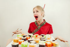 Girl with sushi Royalty Free Stock Photos