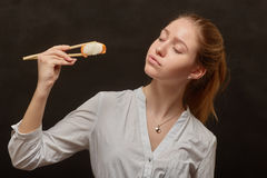 Girl with sushi Royalty Free Stock Photo