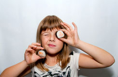 Girl and sushi. Young Girl with sushi in hand near eye - fun pose Stock Photos
