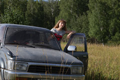Girl and SUV Royalty Free Stock Photo