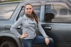 Girl and SUV Stock Photography