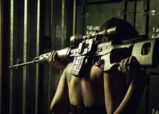 Girl with svd sniper rifle. Girl holding on her shoulders svd sniper rifle. Rear view Stock Photography