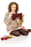Girl in a sweater with a book Royalty Free Stock Photography