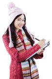Girl with sweater and clipboard in studio Royalty Free Stock Photo