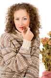 Girl in a sweater eating chocolate candy Royalty Free Stock Photo