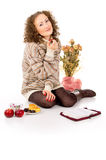 Girl in a sweater eats candy Stock Image