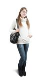 Girl in sweater with handbag Stock Image