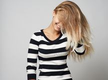 Girl in a sweater hiding   her hair Stock Images