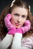 Girl in sweater and mittens Stock Images