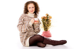 Girl in a sweater with a mug Stock Photo