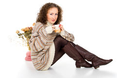 Girl in a sweater with a mug Stock Photos