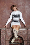 Girl in a sweater and socks Royalty Free Stock Image