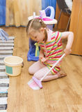 Girl sweeping the floor Royalty Free Stock Photo