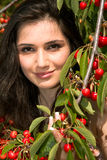 Girl with a sweet cherry Stock Photography