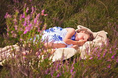 Girl sweet dreaming in heather field Royalty Free Stock Images
