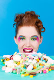Girl with sweet goodies and candy Royalty Free Stock Photos